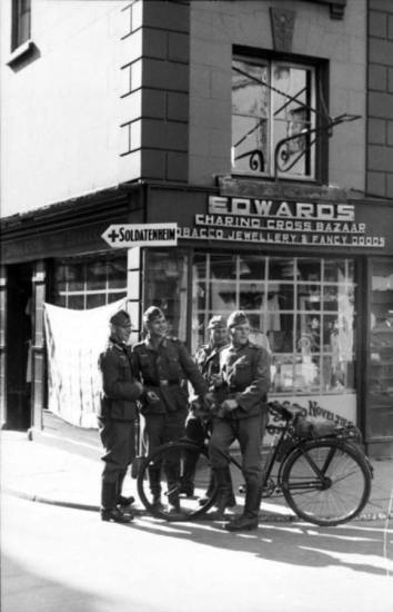German soldiers during the Occupation of Jersey, circa 1941. By 1945, the smiles were gone, replaced by hungry and misery. Bundesarchiv photo