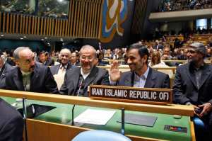 Mahmoud Ahmadinejad (waving), President of the Islamic Republic of Iran, is shown with his delegation in the General Assembly Hall during the general debate of the Assembly's sixty- fourth session, Sept. 23, 2009. President Mahmoud Ahmadinejad has become known for his inflammatory rhetoric toward the U.S. and her allies. U.N. photo by Evan Schneider