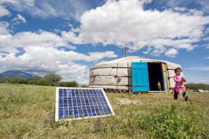 A family in Tarialan, Uvs province, Mongolia, uses a solar panel to generate power for their ger, a traditional Mongolian tent, July, 28, 2009. Solar energy will likely be a key resource technology game changer. U.N.  photo by Eskinder Debebe