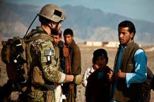 A coalition force member speaks with a villager during a presence patrol in Farah province, Afghanistan, Dec. 16, 2012. The coalition forces conducting the presence patrol are deployed to train and mentor Afghan National Security Forces in their area. Afghan National Security Forces have been taking the lead in security operations, with coalition forces as mentors, to bring security and stability to the people of the Islamic Republic of Afghanistan. U.S. Marine Corps photo by Sgt. Pete Thibodeau