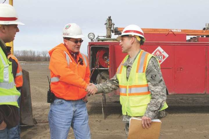 Col. Anthony Hofmann, USACE Kansas City District commander, and Bob Schoen (left) of the Kansas City District meet with ESI Contracting Corp. owner Alan Wolfe (center) Feb. 22, 2012, at the Rushville Sugar Lake Levee. The district contracted with ESI to repair the levee after it breached in several spots during the 2011 Missouri River flood. U.S. Army Corps of Engineers photo by Jennie Wilson