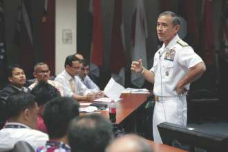 Adm. Harry B. Harris Jr., commander of the U.S. Pacific Fleet, addresses the Fellows of Advanced Security Cooperation (ASC) attending the ASC course at the Asia-Pacific Center for Security Studies, Honolulu, Hawaii, April 16, 2014. The course was designed to advance knowledge, skills, and networks related to multilateral security cooperation in the Asia-Pacific region among mid-career security practitioners. Photo courtesy of APCSS