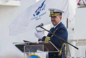 Capt. Doug Fears, commanding officer of Coast Guard Cutter Hamilton, addresses the crew and audience at the commissioning ceremony Dec. 6, 2014. U.S. Coast Guard photo by Petty Officer 1st Class Stephen Lehmann