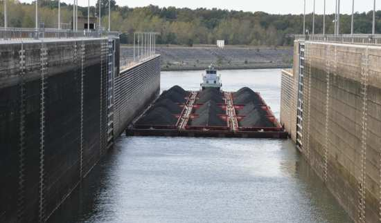A 12-barge tow enters Pickwick Lock in Counce, Tennessee, Oct. 24, 2013. Pickwick is one of nine Tennessee Valley Authority (TVA) navigation locks on the Tennessee River that are operated and maintained by the U.S. Army Corps of Engineers Nashville District. TVA and the district have a long-standing working relationship. Such partnerships foster smarter project work and use of budget dollars. USACE photo by Fred Tucker