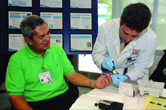 Retired U.S. Air Force Master Sgt. Alfredo Alferez undergoes a screening for diabetes, provided by the 61st Medical Group, at the annual Retiree Expo in the Gordon Conference Center, Los Angeles Air Force Base, California, June 26, 2010. U.S. Air Force photo by Joe Juarez