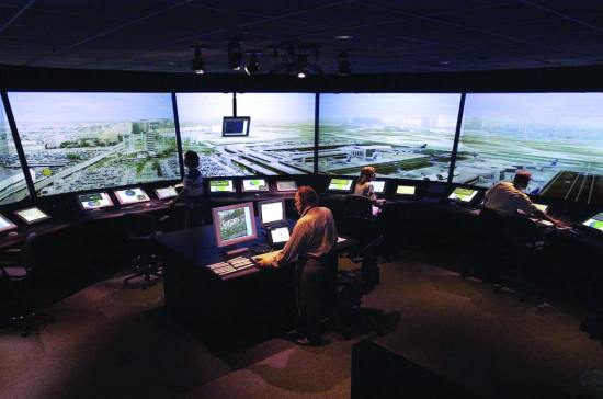 Tower controllers test out new NASA surface automation tools in a simulation at NASA's Future Flight Central air traffic control tower simulator. NASA image