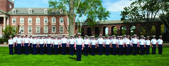 U.S. Coast Guard Academy first-class cadets stand in formation during a regimental change of command at the U.S. Coast Guard Academy in New London, Connecticut, May 10, 2013. The change of command is a time-honored simple ritual, remaining essentially unchanged for centuries of naval history, signifying the transfer of responsibility, authority, and accountability to the assembled crew. U.S. Coast Guard photo by Petty Officer 3rd Class Diana Honings