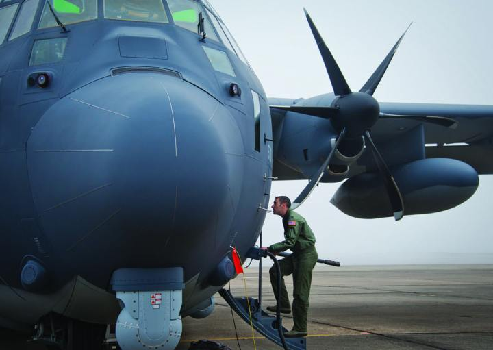 Capt. Steve Visalli, a flight test engineer with the 413th Flight Test Squadron, boards the newly created AC-130J Ghostrider in anticipation of its first official sortie Jan. 31, 2014, at Eglin Air Force Base, Florida. The Air Force Special Operations Command MC-130J arrived at Eglin in January 2013 to begin the modification process for the AC-130J, whose primary mission is close air support, air interdiction, and armed reconnaissance. MC-130J prototypes will be modified as part of a $2.4 billion AC-130J program to grow the future fleet. U.S. Air Force photo/Chrissy Cuttita