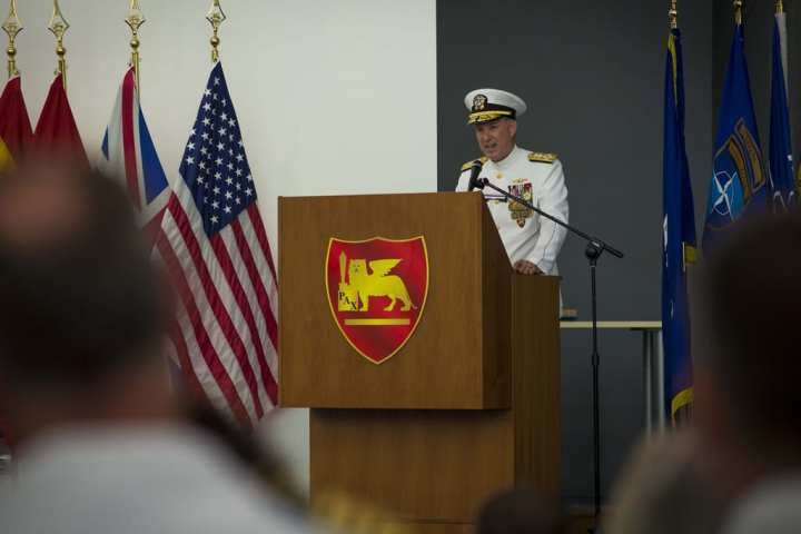 Adm. Mark Ferguson makes his first official remarks after assuming command as commander, Allied Joint Force Command, Naples, commander, U.S. Naval Forces Europe, and commander, U.S. Naval Forces Africa (NAVEUR) during the NAVEUR change-of-command ceremony where Ferguson relieved Adm. Bruce Clingan as the NAVEUR commander. Clingan retired during the ceremony and was presented with the Defense Distinguished Service Medal on behalf of the secretary of defense for his superior service. U.S. Navy photo by Chief Mass Communication Specialist Peter D. Lawlor