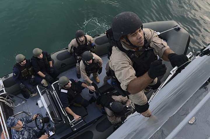 Gunner's Mate 2nd Class Phillip Wright, assigned to the amphibious transport dock ship USS Mesa Verde (LPD 19), boards the Croatian ship HRM Cetina (DBM 81) as part of joint visit, board, search, and seizure (VBSS) training with members of the Croatian and Slovenian navies during a scheduled port visit in Split, Croatia, Oct. 7, 2014. U.S. Navy photo by Mass Communication Specialist 2nd Class Shannon M. Smith