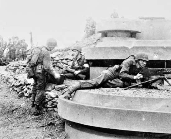 Rangers set up a Browning M1919 .30-caliber light machine gun to secure one of the French gun positions they captured at Arzew.