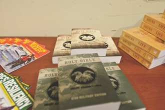 Bibles and other reading material line a desk at the Rural Clergy Training Program (RCTP), a train-the-trainer seminar sponsored by the U.S. Army Reserve Command chaplain office, in collaboration with the VA National Chaplain Center, at the Family Readiness Group Convention Center, Pope Army Airfield, North Carolina, March 2-3, 2016. The RCTP training seminar brought together representatives from all three military components from across the country into a learning environment designed to help facilitate the education of community clergy about how they can support veterans and their family members through the readjustment process. U.S. Army Reserve photo by Brian Godette; USARC Public Affairs