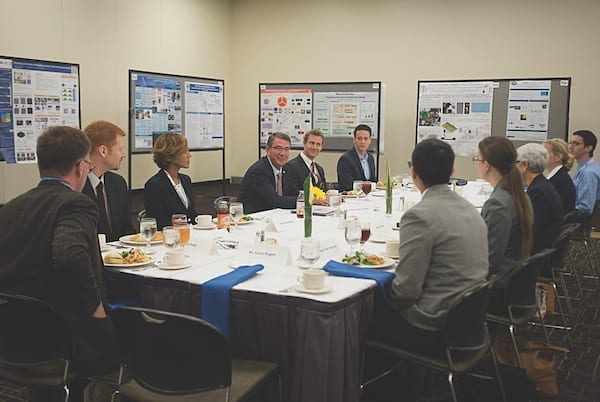 """Former Defense Secretary Ash Carter, center, speaks with a group of early-career """"rising stars"""" over lunch on Sept. 9, 2015, as he attends the DARPA """"Wait, What?"""" future technology forum in St. Louis, Missouri. (DOD PHOTO BY U.S. AIR FORCE SENIOR MASTER SGT. ADRIAN CADIZ)"""