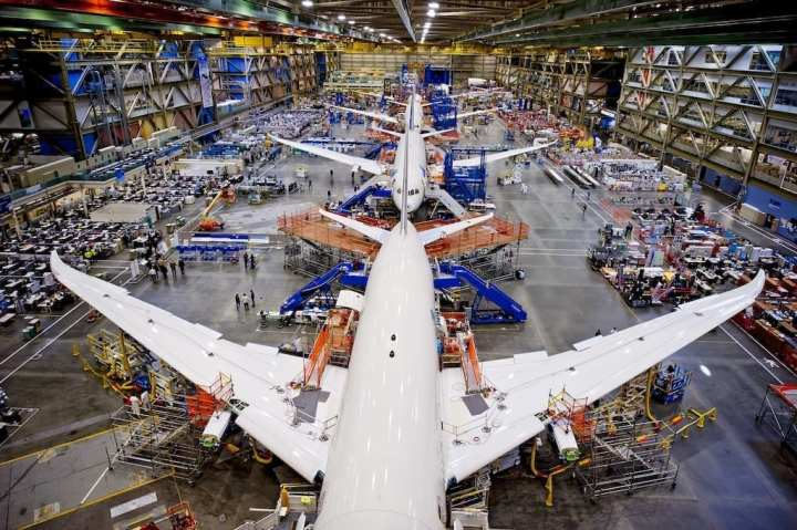 Boeing's 787 on the assembly line. In the 15 years that passed between the earlier 777's maiden flight and the 787's first flight in 2009, composites became a major part of airframes, making aircraft lighter, stronger, and more efficient. BOEING PHOTO