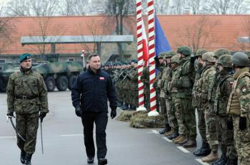 Andrzej Duda, the president of Poland, conducts a pass and review on the parade field during the closing ceremony of ANAKONDA 18 at the Headquarters Multinational Division. Photo Credit: Sgt. 1st Class Craig Norton