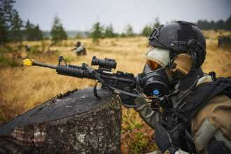 Member of the Special Response Team conducting a Sensitive Site Assessment Mission wearing a CB Lightweight Integrated Thermal Ensemble (CB Lite) Suit. Photo courtesy of U.S. Army Research, Development and Engineering Command staff photographer