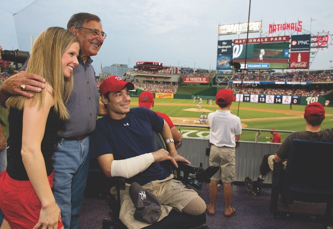 Secretary of Defense Leon Panetta poses for a photo with a wounded warrior from Walter Reed National Military Medical Center during a Washington Nationals baseball game in Washington, D.C., July 18, 2012. DoD photo by Erin A. Kirk-Cuomo