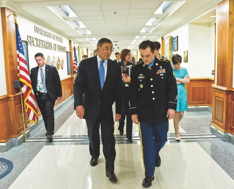 Secretary of Defense Leon Panetta walks through the hallways of the Pentagon with Army Staff Sgt. Clinton Romesha prior to a ceremony at the Pentagon, Feb. 12, 2013. Romesha was presented the Medal of Honor at the White House the previous day by President Barack Obama. DoD photo by Erin A. Kirk-Cuomo