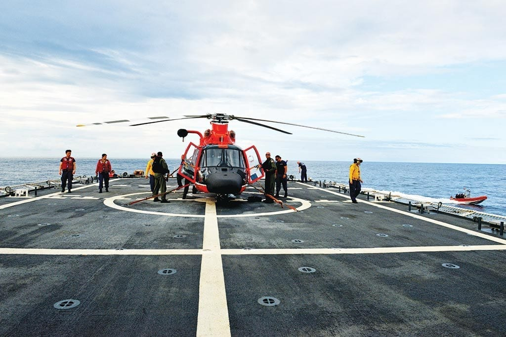 Coast Guard Cutter Bertholfcrewmembers prepare to launch an MH-65 Dolphin helicopter from the cutter's flight deck during a counterdrug patrol in the Eastern Pacific Ocean, March 8, 2018. Aircrew members from Helicopter Interdiction Tactical Squadron aircrew and Air Station Humboldt Bay deployed aboard Bertholf, with the MH-65 Dolphin acting asa force multiplier during the cutter's counterdrug patrol.