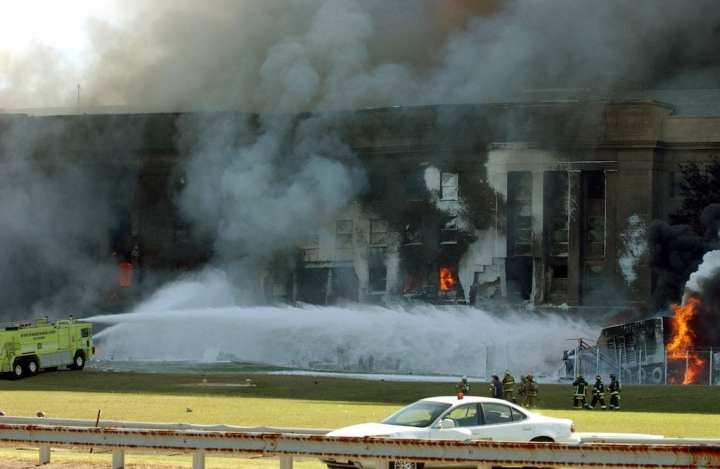 The Pentagon in flames just minutes after a hijacked jetliner crashed into the building on Sept. 11, 2001. One of the fire trucks dispatched from the Ronald Reagan Washington National Airport battles the fire. U.S. Marine Corps photo by Cpl. Jason Ingersoll