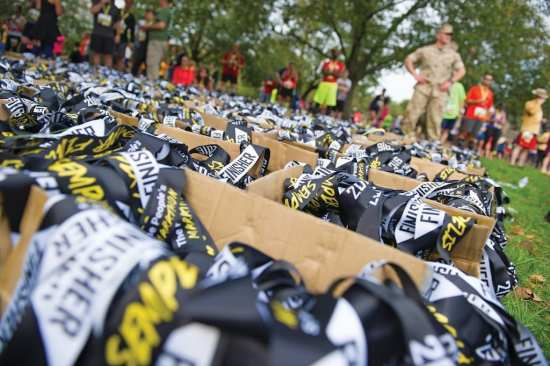 Boxes of finisher medals at the 41st Marine Corps Marathon in 2016. The marathon begins between the Pentagon and Arlington National Cemetery, and the course takes runners past DOD headquarters before finishing at the Marine Corps War Memorial. DoD photo by U.S. Army Sgt. First Class Clydell Kinchen
