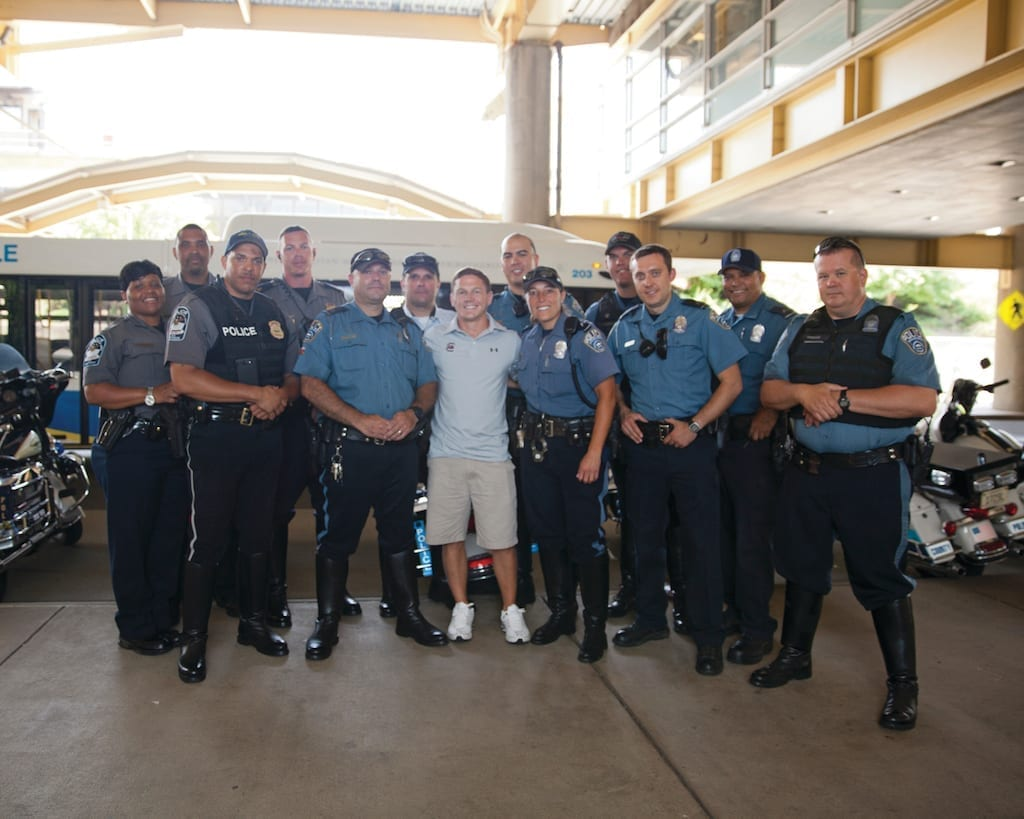 Retired U.S. Marine Corps Cpl. William Kyle Carpenter, center, poses for a photo with Pentagon Force Protection Agency and Arlington County Police Department officers outside Ronald Reagan Washington National Airport in Washington, D.C., June 16, 2014. Carpenter received the Medal of Honor from President Barack Obama during a ceremony at the White House on Thursday, June 19, 2014. DoD photo by Glenn Fawcett