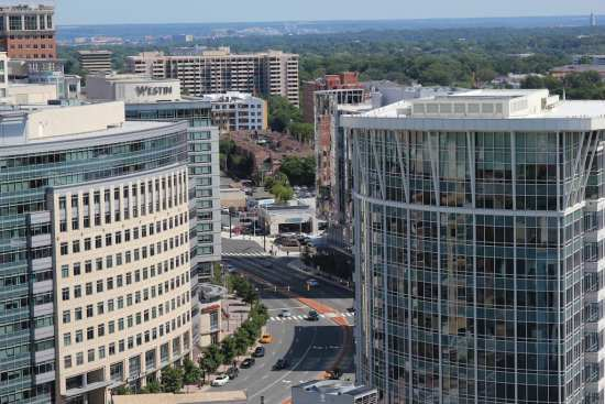 Office buildings and hotels in downtown Arlington, Virginia. The presence of the Pentagon has an effect on the city's commercial real estate market, its ability to draw new businesses to the area, and on travel and tourism.