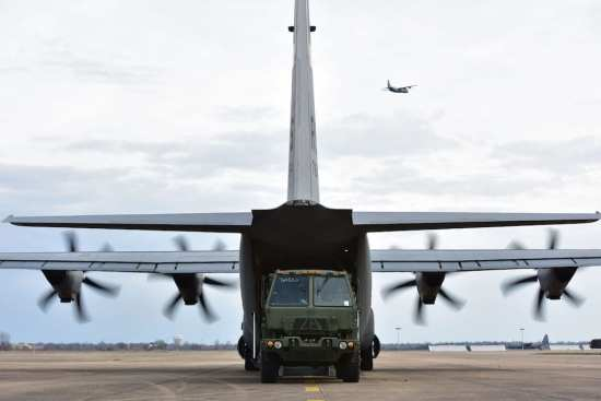 A 5-ton Medium Tactical Vehicle is loaded onto a C-130J during the fly-in exercise at Arkansas International Airport-Byh, March 13, 2019. The fly-in allows for side-by-side training and increases the capability of the C-130J force to operate together cohesively in a deployed environment. (U.S. Air Force photo by Airman 1st Class Aaron Irvin)