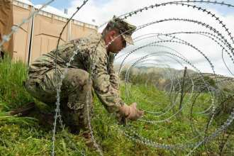 Utilitiesman Constructionman John Manhart, assigned to Naval Mobile Construction Battalion (NMCB) 5, uses pliers to cut barbed wire on Marine Corps Base Camp Pendleton, California as part of Exercise Pacific Blitz (PacBlitz19). NMCB-5 provides support to 1st Marine Logistics Group in the establishment and maintenance of advanced naval bases. PacBlitz19 provides relevant training that replicates a realistic maritime threat environment designed to improve naval amphibious core competencies necessary for effective, global crisis response expected of the Navy and Marine Corps.