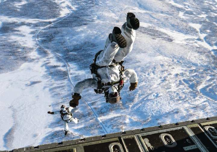 U.S. airmen assigned to the 321st Special Tactics Squadron, 352nd Special Operations Wing conduct freefall airborne operations near Kiruna, Sweden, Feb. 24, 2017. The Arctic winter training included four weeks of basic winter warfare exercises