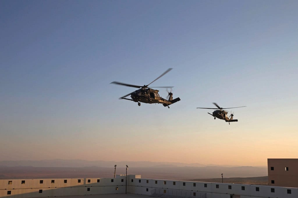 U.S. Army MH-60M Blackhawk's assigned to Marine Aviation Weapons and Tactics Squadron One (MAWTS-1) prepare to evacuate a casualty during Assault Support Tactics 3 (AST-3) in support of Weapons and Tactics Instructor course (WTI) 1-18 at Twentynine Palms, Calif., on Oct. 13, 2017.