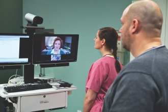 Nurses participate in a video conference at the VA Sierra Nevada Health Care System (VASNHCS) Medical Center. VASNHCS' telehealth services include primary care, nutrition, mental health, women's care, urology, wound care, and more. VA Image
