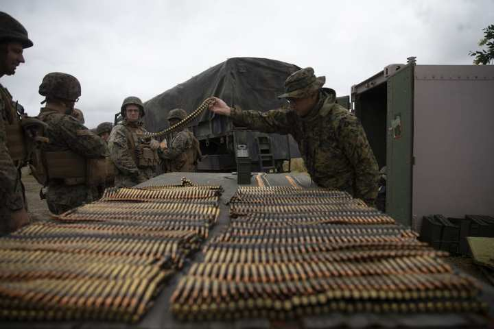 U.S. Marines with Combat Logistics Regiment 15 receive ammunition during a live fire exercise at Marine Corps Base Camp Pendleton, California, May 16, 2019. Marines conduct live fire exercises to maintain combat readiness and effectiveness when employing various weapon systems. U.S. Marine Corps photo