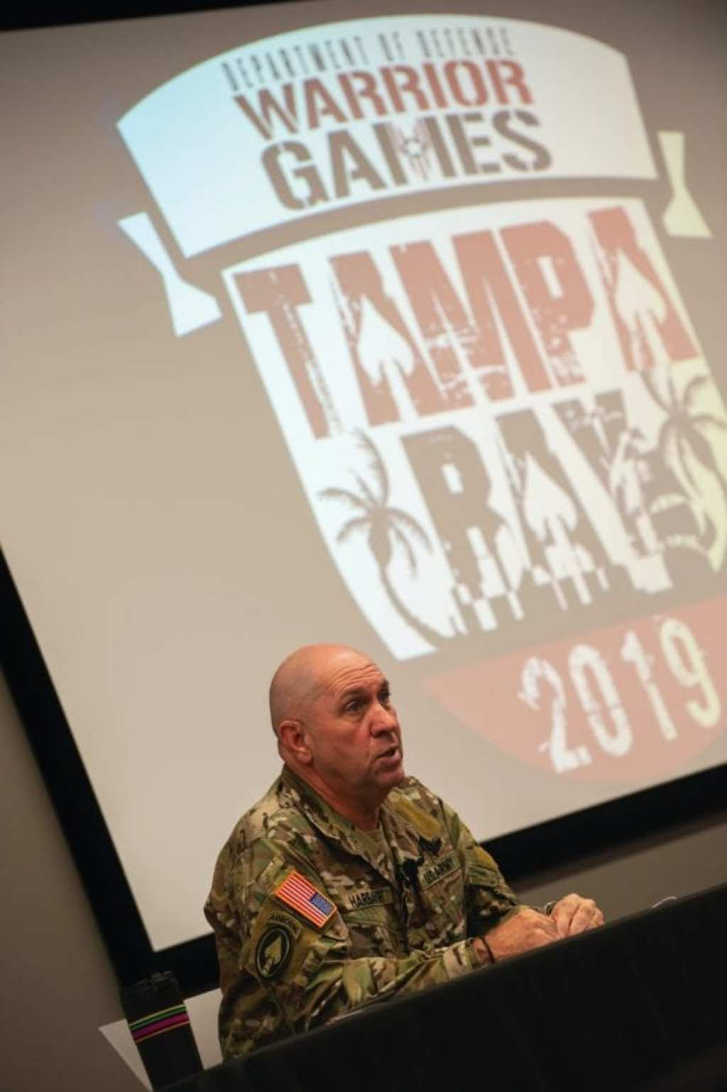 Army Col. Cary Harbaugh, U.S. Special Operations Command Warrior Games 2019 director, briefs local media on the 2019 DoD Warrior Games in Tampa, Florida, Aug. 6, 2018. In the games, scheduled from June 21-30, 2019, more than 300 athletes will compete in 14 events located in downtown Tampa and surrounding areas