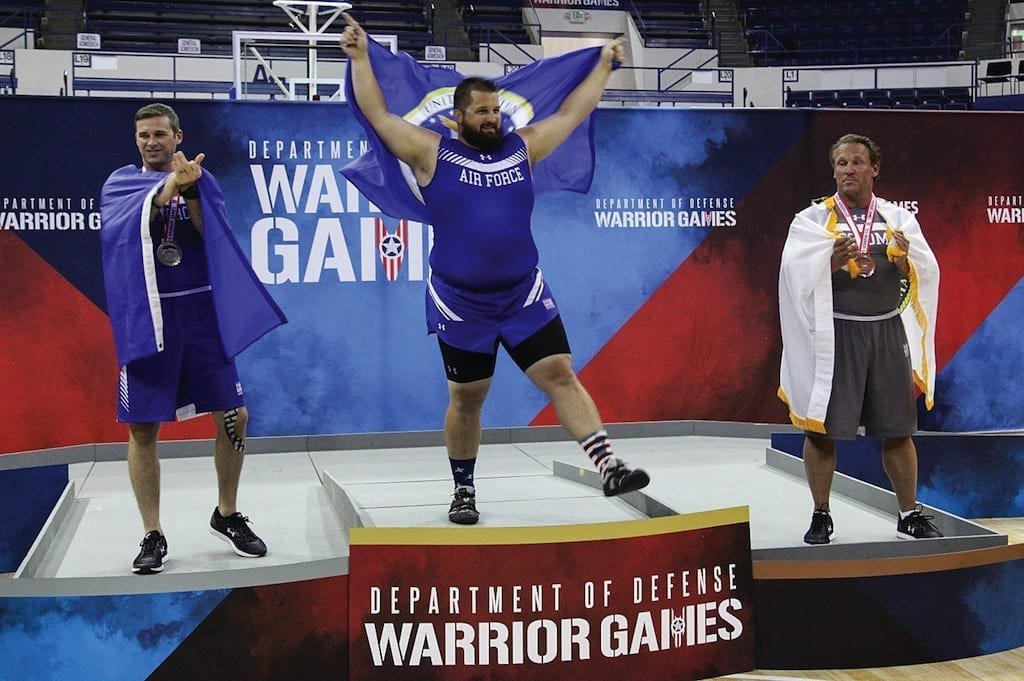 Medalists celebrate their win in the indoor rowing event of the DOD Warrior Games at the U.S. Air Force Academy in Colorado Springs, Colorado on June 9, 2018. The Warrior Games enhance the recovery and rehabilitation of wounded, ill, and injured service members through adaptive sports.