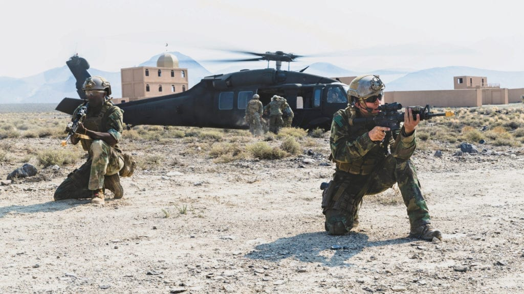 Marines with 1st Marine Raider Support Battalion post security during a medical evacuation exercise at a training area in Hawthorne, NV, during Training Readiness Exercise II, July 28, 2018. The purpose of this training was to create a realistic simulation of multiple operating environments while challenging the team with a hybrid threat