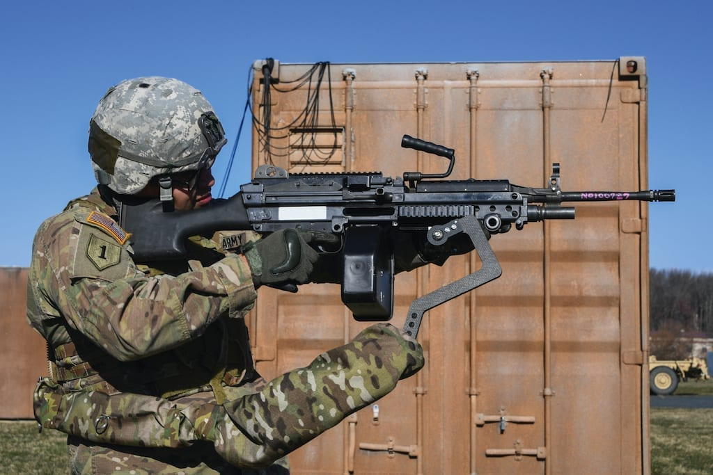 Army Sgt. Michael Zamora uses a prototype Third Arm exoskeleton to easily aim an 18-pound M249 light machine gun during testing at Aberdeen Proving Ground, Maryland, March 14, 2018.