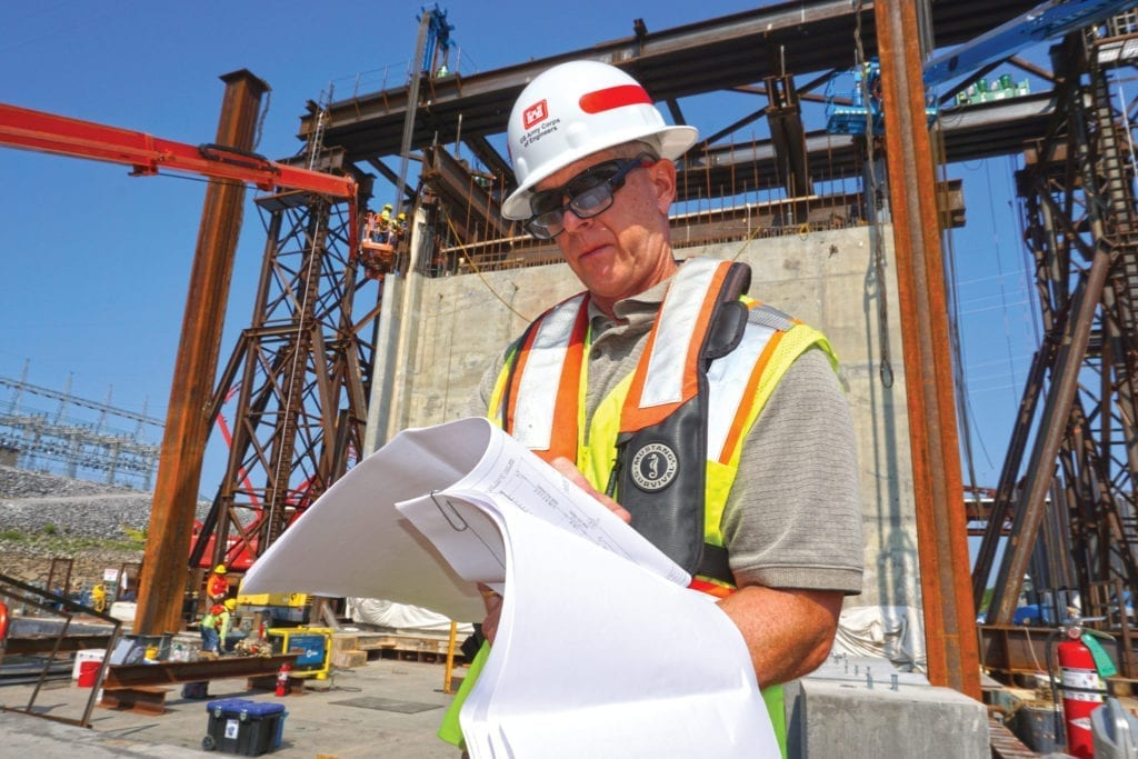 Barney Schulte, technical engineer for Kentucky Lock Addition Project, checks specifications for the gantry crane lift system in preparation for the movement of a 1.3-million-pound concrete shell Aug. 4, 2018, into the downstream riverbed to form a cofferdam. The shell will also be part of the permanent lock wall.