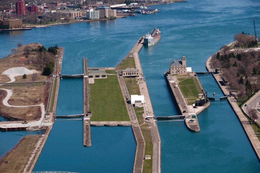 An artist's rendition that illustrates what it might look like if a second Poe-sized lock replaced two of the older locks (left portion of the photo). The Poe Lock, opened in 1969, was the last lock built in the Soo Locks system, the only passage between Lake Superior and the lower lakes. A second Poe-sized lock (far left), the Poe Lock (center), and MacArthur Lock (far right).