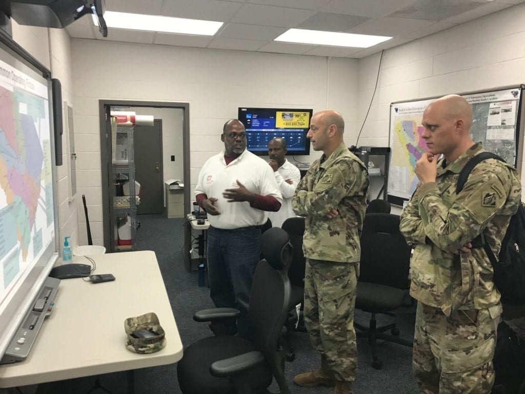 Maj. Gen. Scott Spellmon, deputy commanding general for Civil and Emergency Operations (center), discusses the emergency response plan for South Carolina following Hurricane Florence, with Keith Skinner, emergency management specialist.