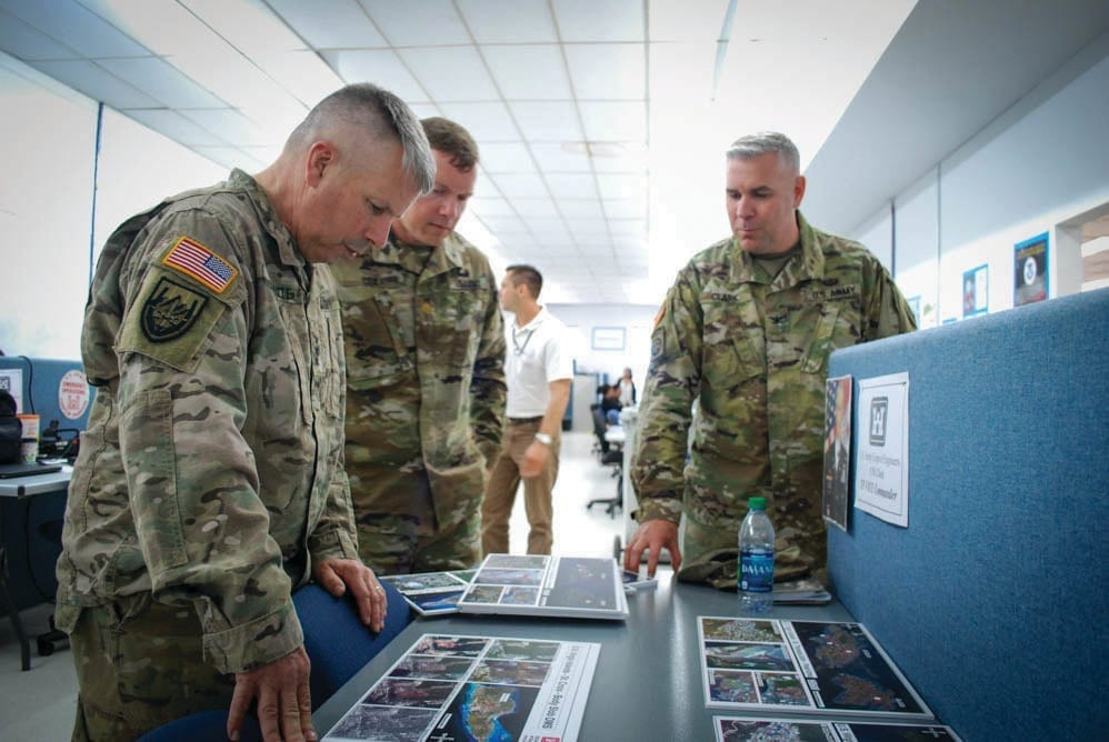 USACE's Lt. Gen. Todd Semonite, receives an update from Maj. Yanson Cox, Wilmington District deputy commander and Recovery Field Office (RFO) deputy commander, and Col. Robert J. Clark, Wilmington District commander and RFO commander, on debris removal efforts on St. Croix in the U.S. Virgin Islands April 11, 2018. Semonite also took the opportunity to thank personnel and recognize the team's efforts.
