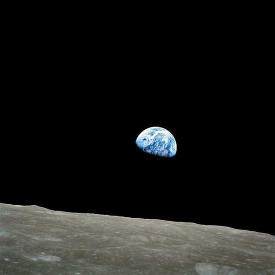 This view of the rising Earth greeted the Apollo 8 astronauts as they came from behind the Moon after the lunar orbit insertion burn. It became one of the most famous photographs in history