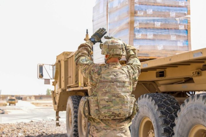 U.S. Army Spc. Gabriel Garzon, a motor transport operator assigned to Company J, 1st Battalion, 41st Infantry Regiment, 2nd Infantry Brigade Combat Team, 4th Infantry Division, ground guides a military vehicle, Sept. 6, 2018, in Afghanistan. (U.S. Army photo by Staff Sgt. Neysa Canfield)