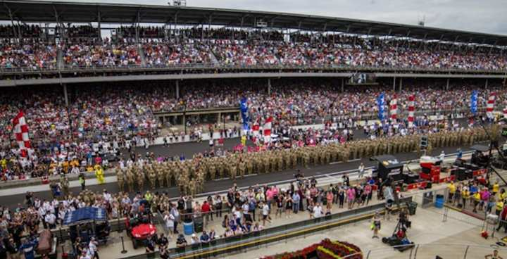 Soldiers of the 38th Infantry Division marched over the Indianapolis Motor Speedway brick line to the sounds of thunderous applause. Gen. Michael X. Garrett, Army Forces Command Commanding General, saw the troops off during their departure ceremony. Approximately 600 division soldiers are slated to deploy to the Middle East in support of Task Force Spartan to help foster partnerships, increase security and self-reliance throughout the region. (U.S. Army Photo by Spc. Joshua A. Syberg / Released)
