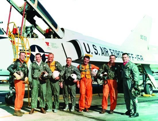 "The original Mercury Seven astronauts with a U.S. Air Force F-106B jet aircraft. From left to right: M. Scott Carpenter, Leroy Gordon Cooper, John H. Glenn, Jr., Virgil I. ""Gus"" Grissom, Jr., Walter M. ""Wally"" Schirra, Jr., Alan B. Shepard, Jr., and Donald K. ""Deke"" Slayton."