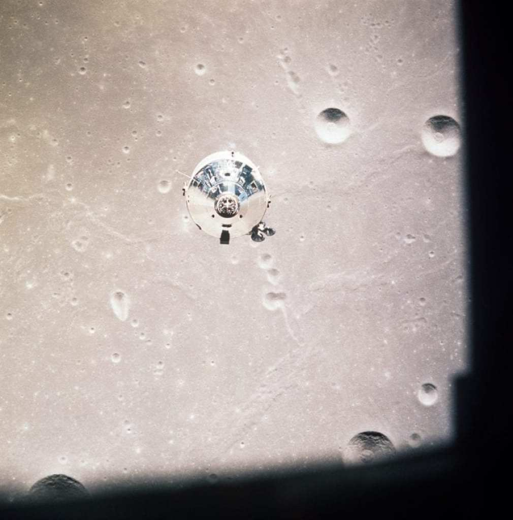 The Apollo 11 command and service modules (CSM) comprising Columbia are photographed from the lunar module Eagle (LM) in lunar orbit during the Apollo 11 lunar landing mission.