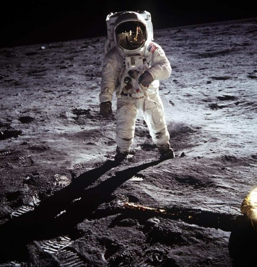 Astronaut Edwin E. Aldrin, Jr., lunar module pilot, walks on the surface of the Moon near the leg of the lunar module (LM) Eagle during the Apollo 11 exravehicular activity (EVA). Astronaut Neil A. Armstrong, commander, took this photograph with a 70mm lunar surface camera