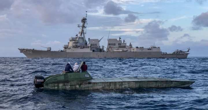 The Arleigh Burke-class guided-missile destroyer USS Michael Murphy's (DDG 112) interceptor team provides security from the ship's rigid-hull inflatable boat after a low profile vessel was sighted by an MH-60R Sea Hawk. (U.S. Navy photo by Command Master Chief Jose Ramiro)