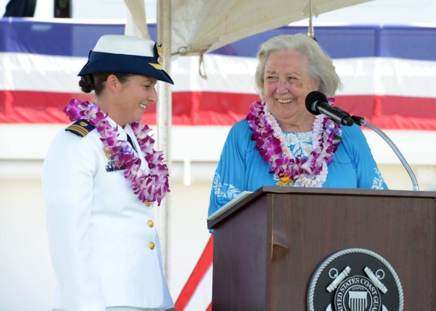 Margaret Hart Davis, the sponsor of the Coast Guard Cutter William Hart (WPC 1134), brings the cutter to life with Lt. Cmdr. Laura Foster, the cutters commanding officer, during a commissioning ceremony at Base Honolulu, Sept. 26, 2019. Davis is the daughter of William Hart who was a Gold lifesaving medal recipient and a World War II veteran. (U.S. Coast Guard photo by Petty Officer 3rd Class Matthew West/Released)