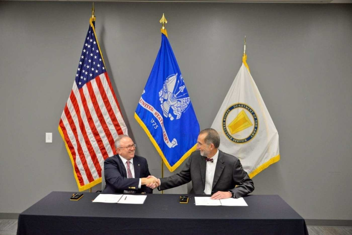 Dr. Barton H. Halpern, director of the Army Research Office, an element of the U.S. Army Combat Capabilities Development Command's Army Research Laboratory (left), and Dr. William Roper, UNC System interim president (right) formed a new partnership between the Army and individual UNC System institutions to stimulate student interest in STEM education, particularly in areas of relevance to the Department of Defense's mission. The Educational Partnership Agreement will facilitate sharing of information and resources between the Army and individual UNC institutions.